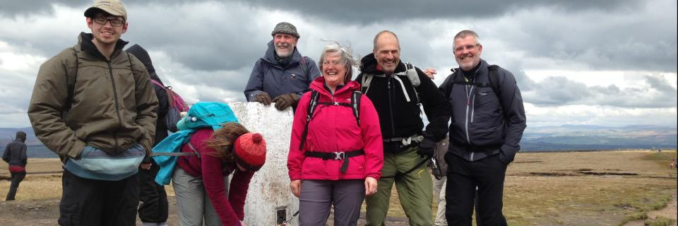 A group of volunteers at the summit of Pendle Hill