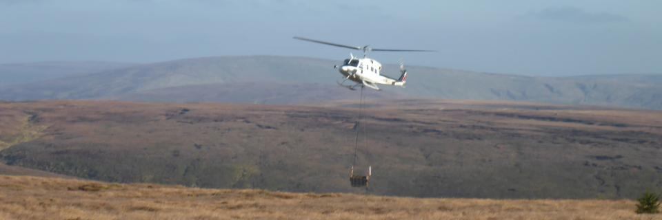 Helicopter lifting materials for peatland restoration at Langden Head.